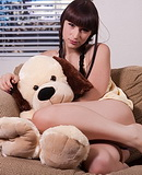 Large stuffed dog TS sweetheart Bailey Jay playing with a stuffed dog.