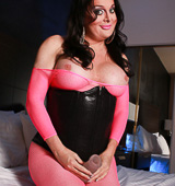 Pink anatomy stocking and toy Hot Wendy playing in bodysuit & corset. Wendy Williams.