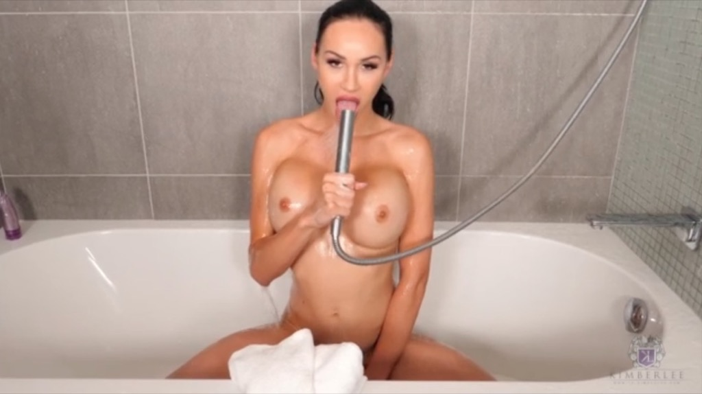 Kimberlee gets super lascivious after a hot bath and pleasures herself with a purple toy
